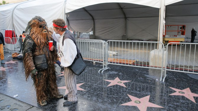 Mandatory Credit: Photo by Chelsea Lauren/REX Shutterstock (5491156ae) Star Wars fans camp out side the Chinese Theatre ahead of mondays film premiere 'Star Wars: The Force Awakens' fans camp out ahead of film premiere, Los Angeles, America - 11 Dec 2015