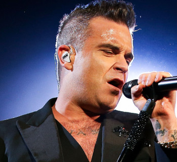 WELLINGTON, NEW ZEALAND - OCTOBER 31:  Robbie Williams performs live during his 'Let Me Entertain You' tour at Basin Reserve on October 31, 2015 in Wellington, New Zealand.  (Photo by Hagen Hopkins/Getty Images)