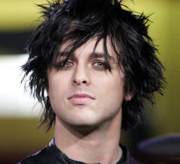 "Billie Joe Armstrong of the band ""Green Day"" appears on stage during MTV's ""Total Request Live""  show at the MTV Times Square Studios, Thursday, Nov. 10, 2005, in New York. (AP Photo/Jeff Christensen)"